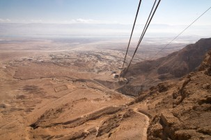 Looking down from Masada on the cable car ride up. A small strip of the Dead Sea is visible as are mountains in Jordan